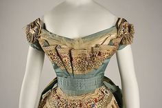 Blue silk taffeta ball gown with brocade and fringe trim (detail of alternate bodice), by Charles Frederick Worth, French, ca. 1872.