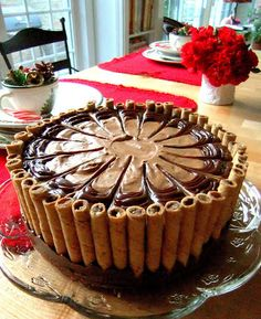 Death By Chocolate Cake -  delicious layers of brownies, chocolate pudding, whipped cream and heath toffee bar bits meld together to create this luscious and creamy dessert. You can use homemade brownies and chocolate custard, or use boxed recipes, depending on time. Pour some chocolate or coffee-flavored liqueur over the brownies as a variation to kick it up a notch.
