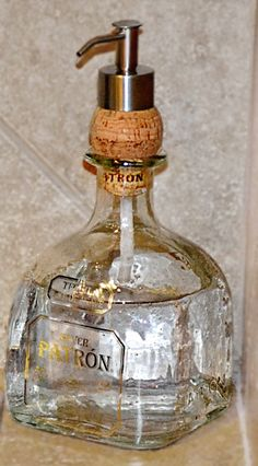 I love the idea of putting the dispenser through a cork - so easy!! - BASEMENT BAR- great soap dispenser!