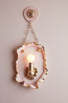 Collaboration Between Pamela Shamshiri and Sonia Boyajian Births Chic Jewelry Store. Boyajian's custom sconce adapted from one of her earring designs. Photography by Stephen Busken. Jewellery Shop Design, Jewelry Shop, Jewelry Stores, Ceramic Workshop, Ceramic Studio, Pink Palace, Metal Magazine, Custom Made Furniture, Elements Of Art