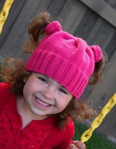 Free Knitting Pattern for Nippertail Pigtail Hat - This hat has little turtlenecks to accomodate pigtails. Jenn Jarvis provides multiple options for position of the holes and design of the hat. Pictured project by angifitz