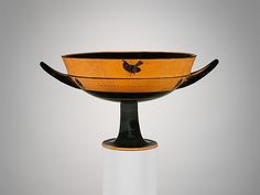 Signed by Tleson | Terracotta kylix: lip-cup (drinking cup) | Greek, Attic | Archaic, ca. 540 B.C. | The Met
