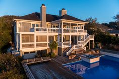 After a day on the boat or paddleboard - return to cool down in the waterfront pool or relax in the hot tub before entering this stylish well-appointed 4500+sqft coastal home. Spectacular water views showcased from multiple exterior decks and nearly every room in the house. Open flowing living, dining, kitchen level floorplan excellent for entertaining. Spacious waterfront master suite. Additional features include sizeable workshop, mature landscaping, multiple garages.