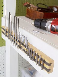 28 Brilliant Garage Organization Ideas | Use a magnet strip to hold drill bits, screws, wrenches, etc...