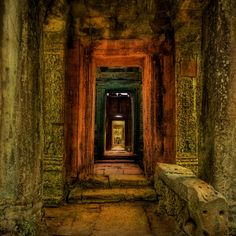 Cambodia ~ This temple laid under the jungle, completely undiscovered for centuries. The hallway and mysterious chambers seemed to go on forever.