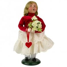 Byers' Choice Valentine Girl   Our Valentine Girl for 2015 is smartly dressed in a bright red blouse and white eyelet skirt. She holds a bouquet of flowers from her admirer along with a heart shaped valentine pendant.