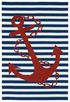 Bright, bold classic nautical motif and colors make up this Seaworthy Navy Striped Anchor Rug, perfect for indoor, or outdoor spaces to complete your maritime look!