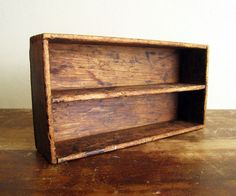 "Divided Wood Box : Rustic and Weathered. Wood is weathered and worn, with some small paint spots on one side.  Measures:  12"" wide.  6 1/4"" deep.  3"" tall.  Each compartment measures 11 1/4"" x 2 1/2"""