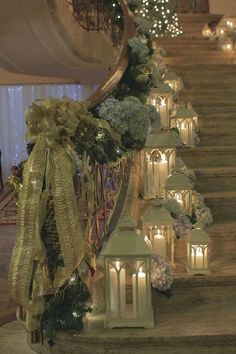 Gorgeous staircase with ribbons, flowers, candles and lanterns