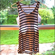 Black/White Open Sides Tank Top Open sides tank top with black and white stripes. Bit of wear on the shirt, but still looks great.                                                                                  Offers Welcome, No Pay-Pal  Non-Smoking Area Same/Next Day Shipping tresics Tops Tank Tops