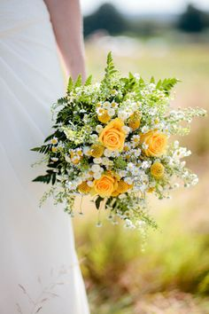 Summer wedding bouquet posy with gold roses and white daisies