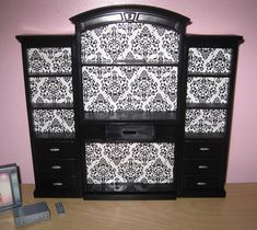 Entertainment Center Repurpose for baby room for extra storage?