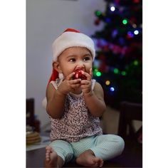 Little baby girls's first Christmas... Bauble-ing her way through!