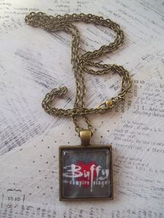 http://www.etsy.com/shop/JennyLeeBoutique Buffy the Vampire Slayer Logo Glass Photo Pendant in a Solid Bronze Setting with an Elegant Bronze Link Necklace. $10.00, via Etsy.