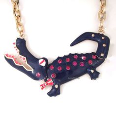 Sparkly gator necklace with moving bits.