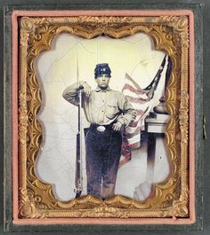 Library of Congress image:Unidentified soldier in Union uniform with bayoneted musket in front of painted backdrop showing American flag and column pedestal, donated to the Library of Congress 2012 by Tom Liljenquist; Liljenquist Family Collection of Civil War Photographs.