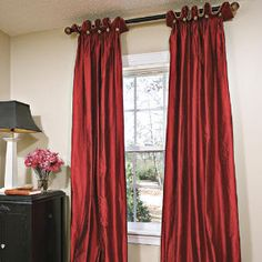 Like the pleat/buttons, master bedroom? I think it would be a nice way of dressing up the simple fabric and color.
