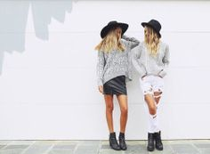 Best friends look cool wearing matching black hats and black boots