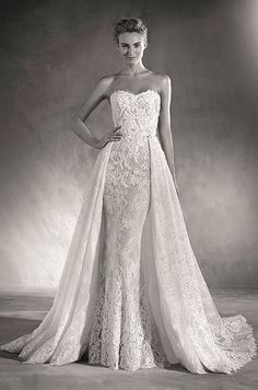An ultra-feminine, sleeveless wedding dress with a sweetheart neckline and a mermaid silhouette. Atelier Pronovias 2017 Bridal Collection