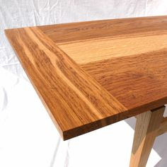 Occaisional table with floating top made from brown oak by David Towers cabinet-maker www.davidtowers.biz
