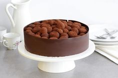If you like chocolate truffles – you're gonna love this cake! This easy-to-make chocolate cake is getting a fancy look by adding chocolate decoration on the sides and lots of chocolate truffles on top. it's chocolate heaven for chocoholics! Chocolate Truffles Cake 24 cm round cake pan For the cake: 100 ml. vegetable oil 100 …