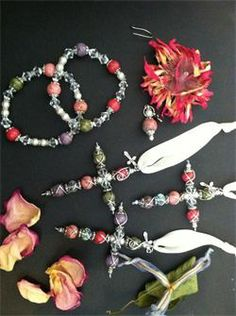 In memory of a sweet mother! Beads made from flower petals.