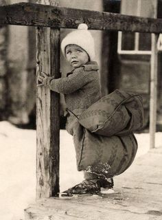 A young Dutch boy has a pillow strapped on his backside to soften the fall on ice while skating. 1930s