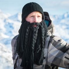 Unleash your inner viking! Our Long Viking Beard hat comes with a long braided black beard. Raise some hell on the slopes or in the streets!