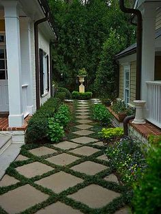 Cheap concrete squares set on the diagonal changes a budget idea to elegance. Try strips of artificial turf between them for low maintenance.