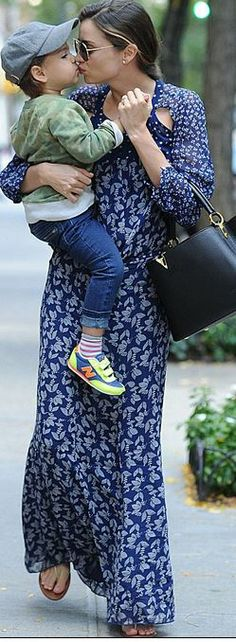 Miranda Kerr: Sunglasses – Oliver Peoples  purse – Louis Vuitton  Dress – Isabel Marant