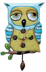 A lovely blue owl clock with an acorn pendulum.