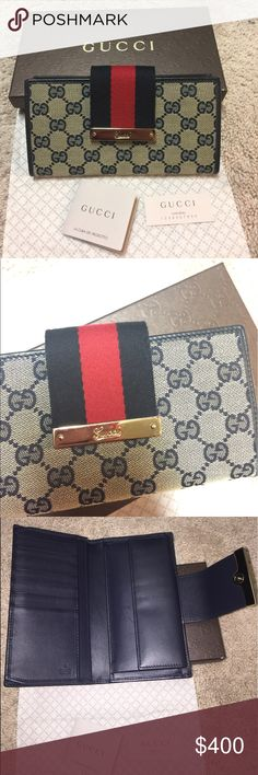 Authentic Gucci Continental Wallet in Navy Barely used. In good condition. Bought from Neiman Marcus. Gucci Bags Wallets