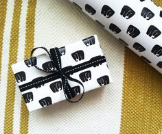 Use black and white paper to wrap your gifts. Add black satin, velvet or grosgrain ribbon to top it off. #ribbon #giftwrap #blackwhite