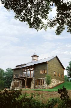 Relocated and renovated barn-home on the Cahaba River in Alabama.Dungan Nequette Architects.
