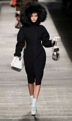 Cara Delevingne walking for #FENDI holding the (now infamous) Karl Lagerfeld doll #Chanel