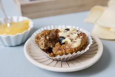 Preheat oven to 180°C/350°F/Gas 4. Line muffin tin with paper cases. Soak the bran in the milk for about 10 minutes. Meanwhile cream butter/margarine and sugar together until light and fluffy. Stir in the egg, bran and milk. Lightly fold in the flour, sieved baking powder and raisins. The mixture should remain a little lumpy. Divide the mixture between the paper cases. Bake for about 20-25 minutes until well risen. Cool on a wire tray. Delicious served warm with butter a...
