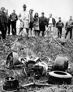 Tragic loss: spectators look at the wreckage of the Lotus car in which Jim Clark died at the Hockenheimring in Germany in 1968