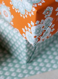 crochet wrap double-sided wrapping paper in orange and teal graphic patterns by smock