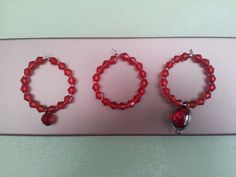 Red with a choice of charms