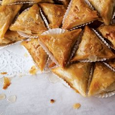 Samsa Feuille de Brick (Fried Almond Pastries) by Saveur. These sticky-sweet fried pastries, drenched in a syrup of honey and orange flower water, are typical of the rustic desserts of Tunisia. Best Pastry Recipe, Puff Pastry Recipes, Köstliche Desserts, Delicious Desserts, Yummy Food, Snack Recipes, Dessert Recipes, Cooking Recipes, Honey Recipes