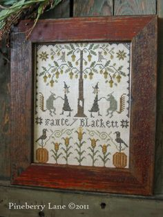 Fancy Blackett and the Harvest Dance - want this pattern. I love the rustic frame. It totally sets the embroidery off.