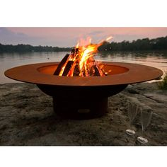 "Rugged and dependable, the Magnum Fire Pitoffers you and your guests the perfect combination of beauty and simplicity. Handcrafted from ¼"" steel, this fire pit is designed to stand the test of time. T"