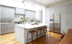 lovely light grey cupboards and open kitchen.