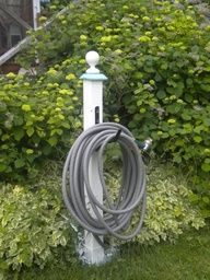 DIY garden hose hanger with 4 x 4 painted wood   finial   hardware store hose holder. So smart and simple!