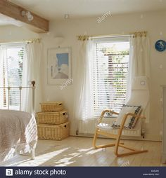 Scandinavian style wooden chair and wicker chests in white bedroom with Venetian blinds and white voile curtains on window Stock Photo House Blinds, Blinds For Windows, Shutter Blinds, Window Blinds, Scandinavian Curtains, Scandinavian Style, White Wooden Blinds, Store Venitien, Voile Curtains