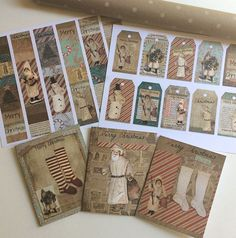 Printable grungy primitive Christmas cards at LetsGetHappyGraphics. Fun coordinating gift tags as well as collage strips which are great to add to your gift wrap. Antique stockings and spun Santa on grungy dirty paper. So cute!