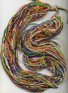 54 strand vintage glass  bead belt primarily worn by the the Fulani or Tusi people.