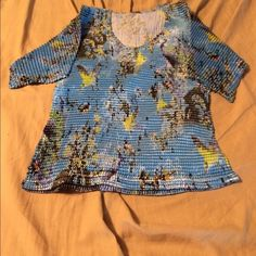 Komarov women's pleated shirt Komarov pleated women's shirt blue appears to have trees and birds on the shirt. Beautiful and amazing unusual great casual and dressed up. Worn a handful of times Komarov Tops Blouses