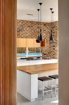 astlecrag Residence by CplusC Architectural Workshop - brick, timber, Tom Dixon Pendants