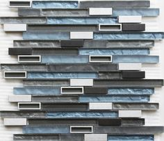 Modern Stainless Glass Mosaic Tile Linear Blue is a combination of glass and natural stone tiles mesh mounted on a 12 inches by 12 inches fiberglass sheet for an easy installation. The tile is thi Modern Kitchen Backsplash, Glass Tile Backsplash, Glass Mosaic Tiles, Grey Feature Wall, Feature Walls, Bathroom Renovations, Bathroom Ideas, Tile Bathrooms, Basement Bathroom